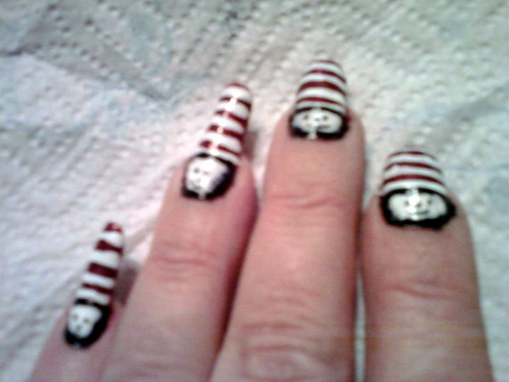 My Cat in the Hat nails. Wear them alot on Dr. Suess' Birthday. I painted my nail white then added the red and black over top the dry white coat.