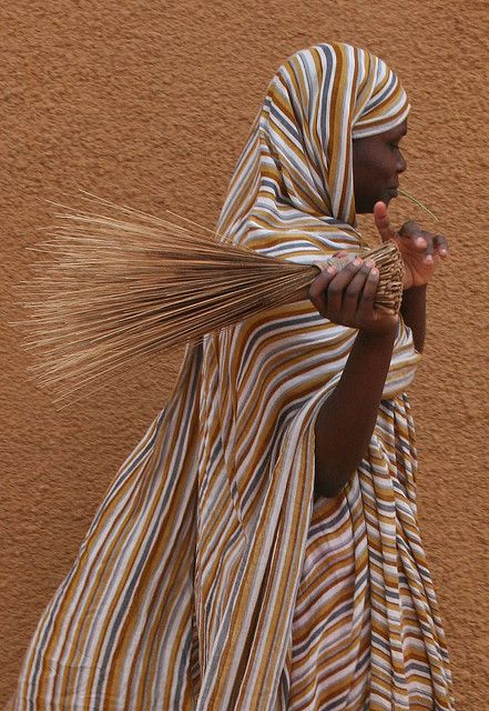 """""""A job to do ..."""" Young girl in Bareina, a small village in the dessert in Mauritania. 
