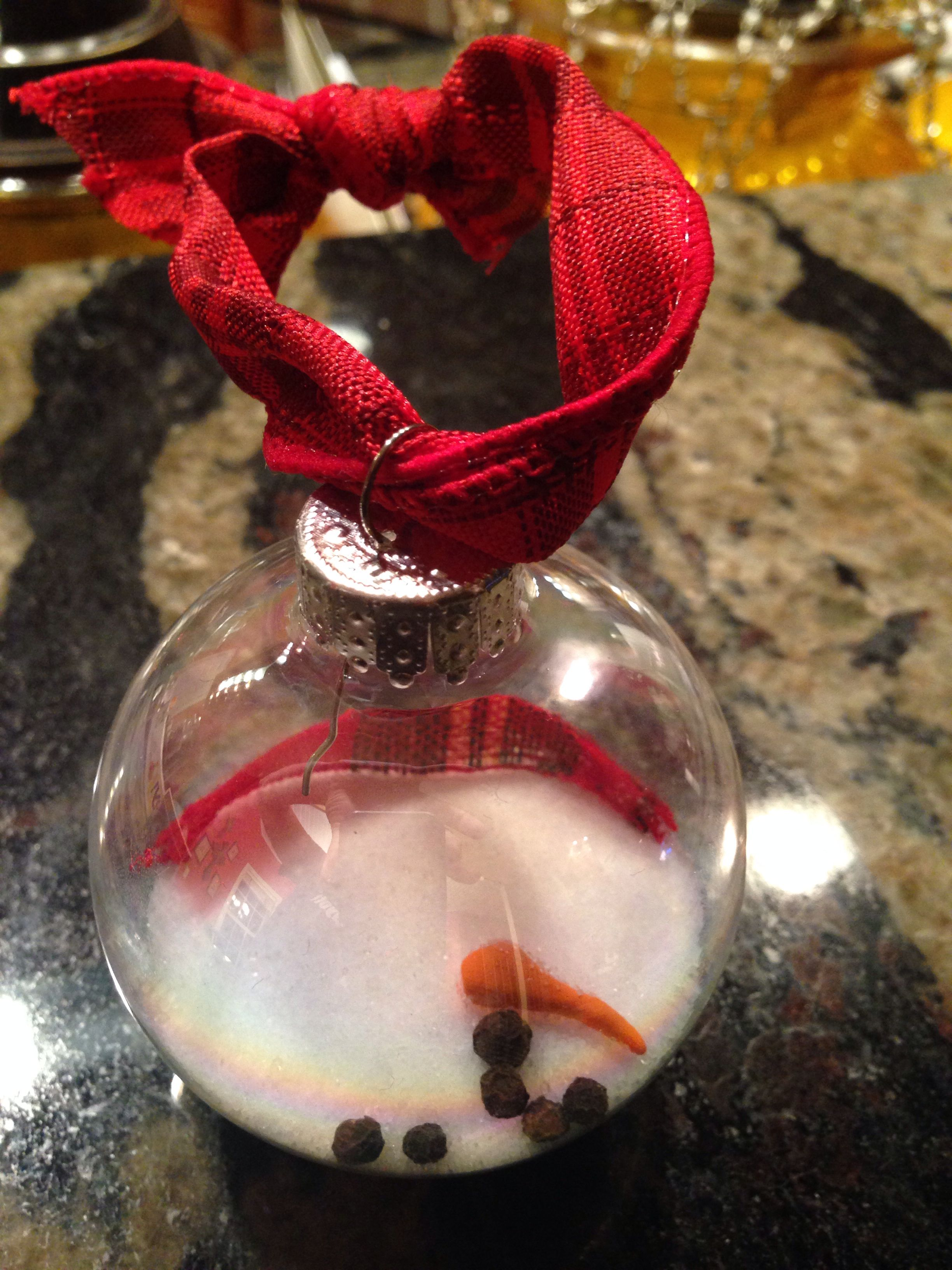 Melted snowman ornaments! Kennedy and I made these with