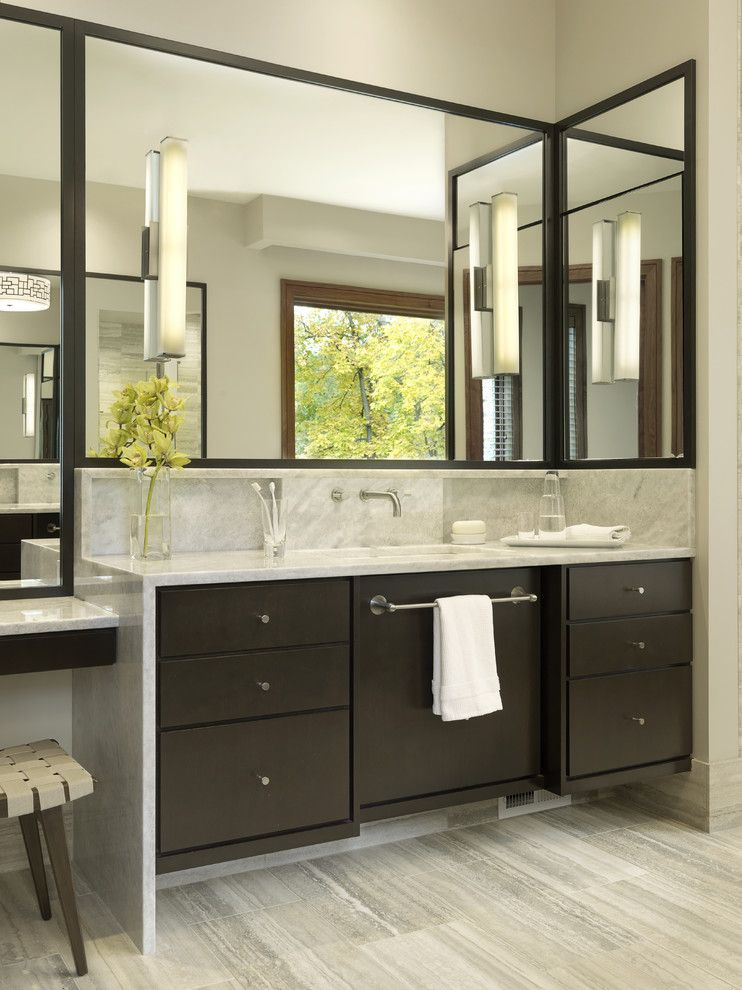modern bathroom with dark wooden cabinet, with towel bar, grey ...