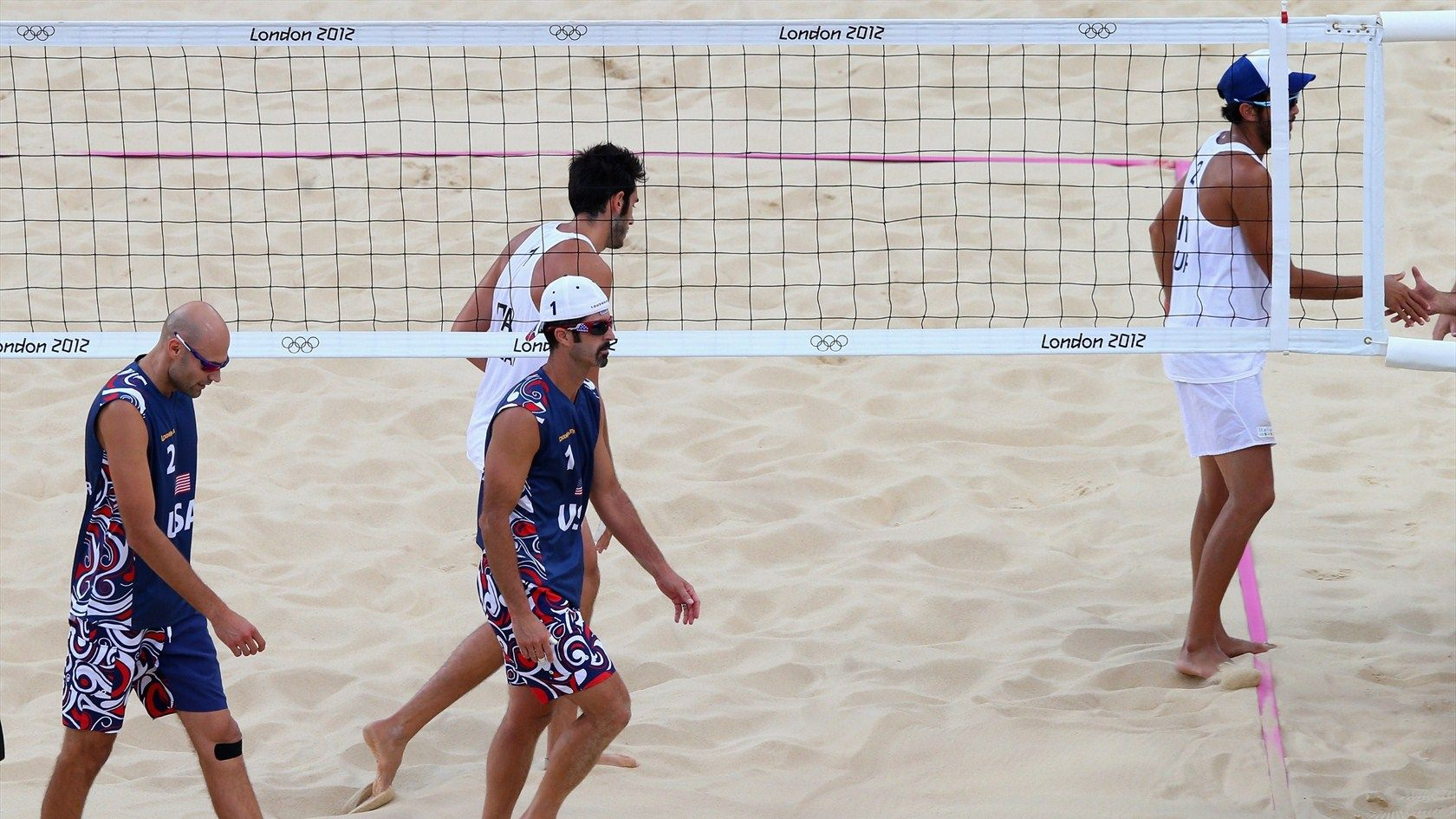 Defending Olympic Champions Phil Dalhausser And Todd Rogers Trudge Off The Court Following Their Shock Loss Volleyball Photos Beach Volleyball Olympic Champion