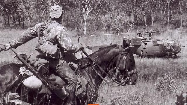 Horse scout soldier of portuguese Army in Mozambique with a german G3.