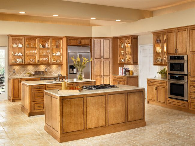 Lighted Cabinets With Bistro Glass Open Up This Luxurious Kitchen While  Dual Islands In Praline With