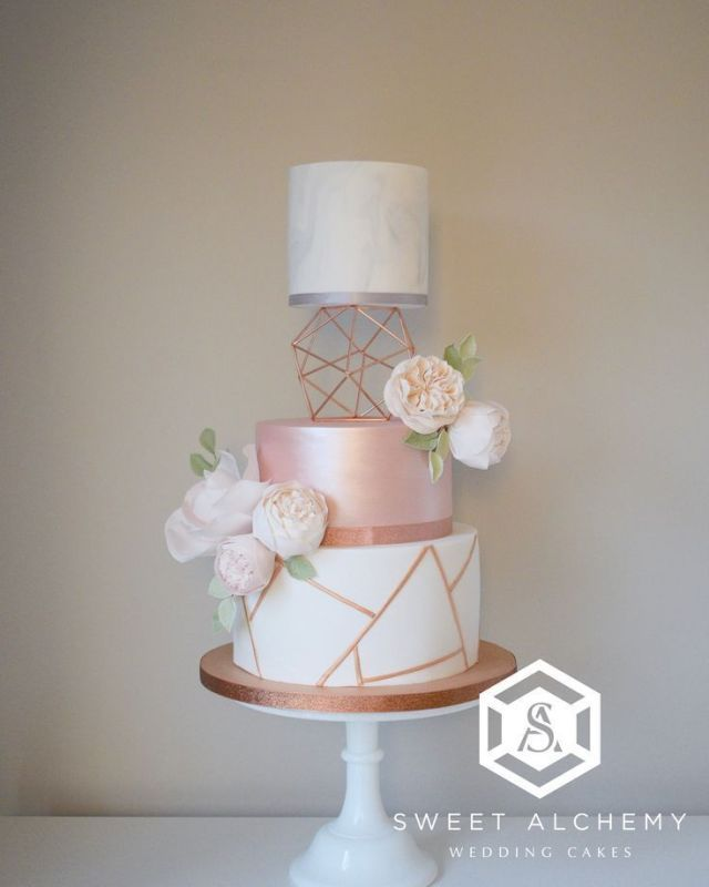 Modern wedding cake in copper and rose gold with geometric copper pattern, ... -   14 wedding Rose Gold cake ideas