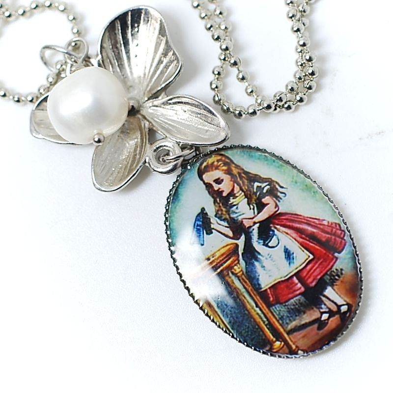 Chain with pendants. Antiqued silver plated brass,  freshwater pearl, cameo with Alice from Wonderland.