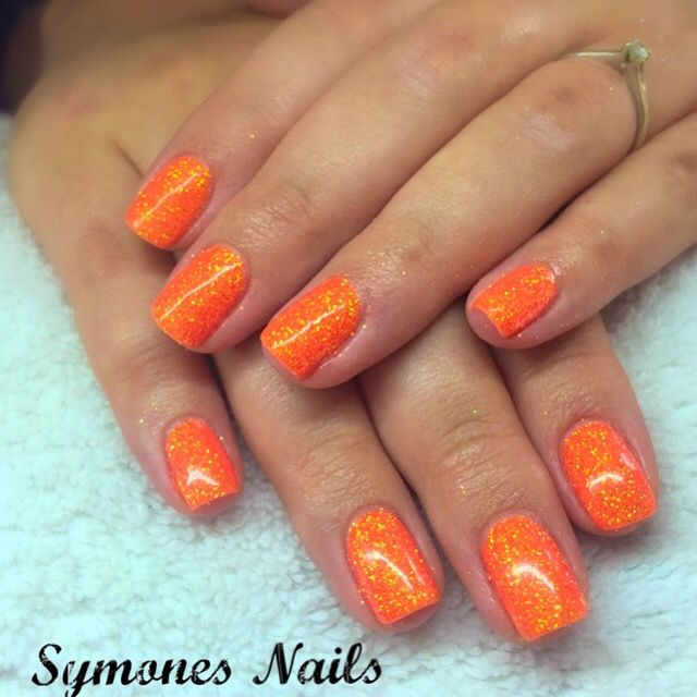 @ibdbeauty gorgeous and vibrant infinitely Curious with Tangerine glitter. Superb holiday colour! #orangenails #glittergel #glitternails #ibdbeauty #symonesnailroom @scratchmagazine