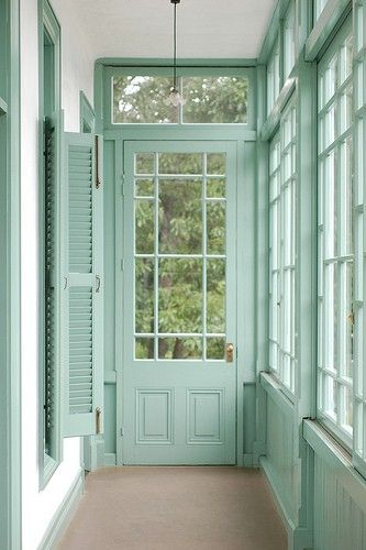 mint green sun room - how inviting! I would like it a bit bigger, and have some comfortable furniture in it. All you can do in this simple room is stare out the windows.