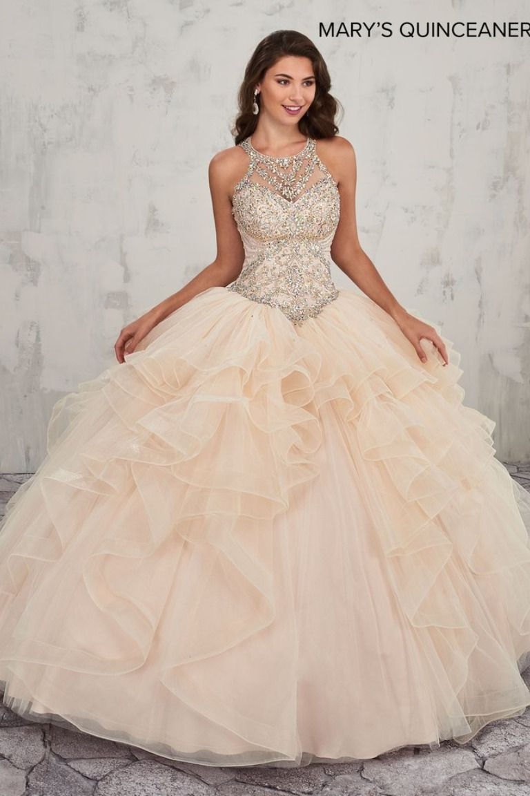 Marys Quinceanera Sparkling tulle strapless quinceanera ball gown features beaded corset bodice with sweetheart neck line, lace-up closure, basque waist line, matching bolero, and chapel train.  Marys Quinceanera Collection Dress  MQ2011. Colors:  Blueberry, Champagne, or White