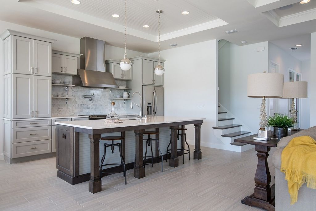 Transitional Kitchen With Flush Flat Panel Cabinets Kitchen Island Travertine Tile Floors
