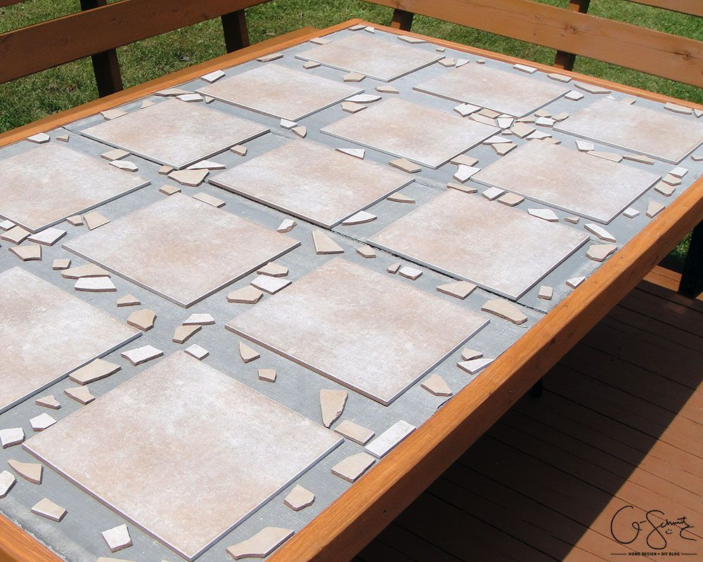 Diy Tiled Table Top With Mosaic Borders By Q Schmitz Featured On Remodelaholic Tile Top Tables Tile Tables Patio Tiles