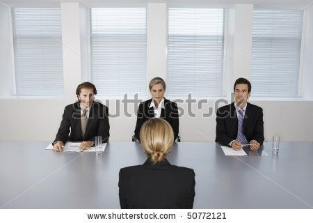 Businesswoman Giving Presentation To Executive Team  Stock Photo