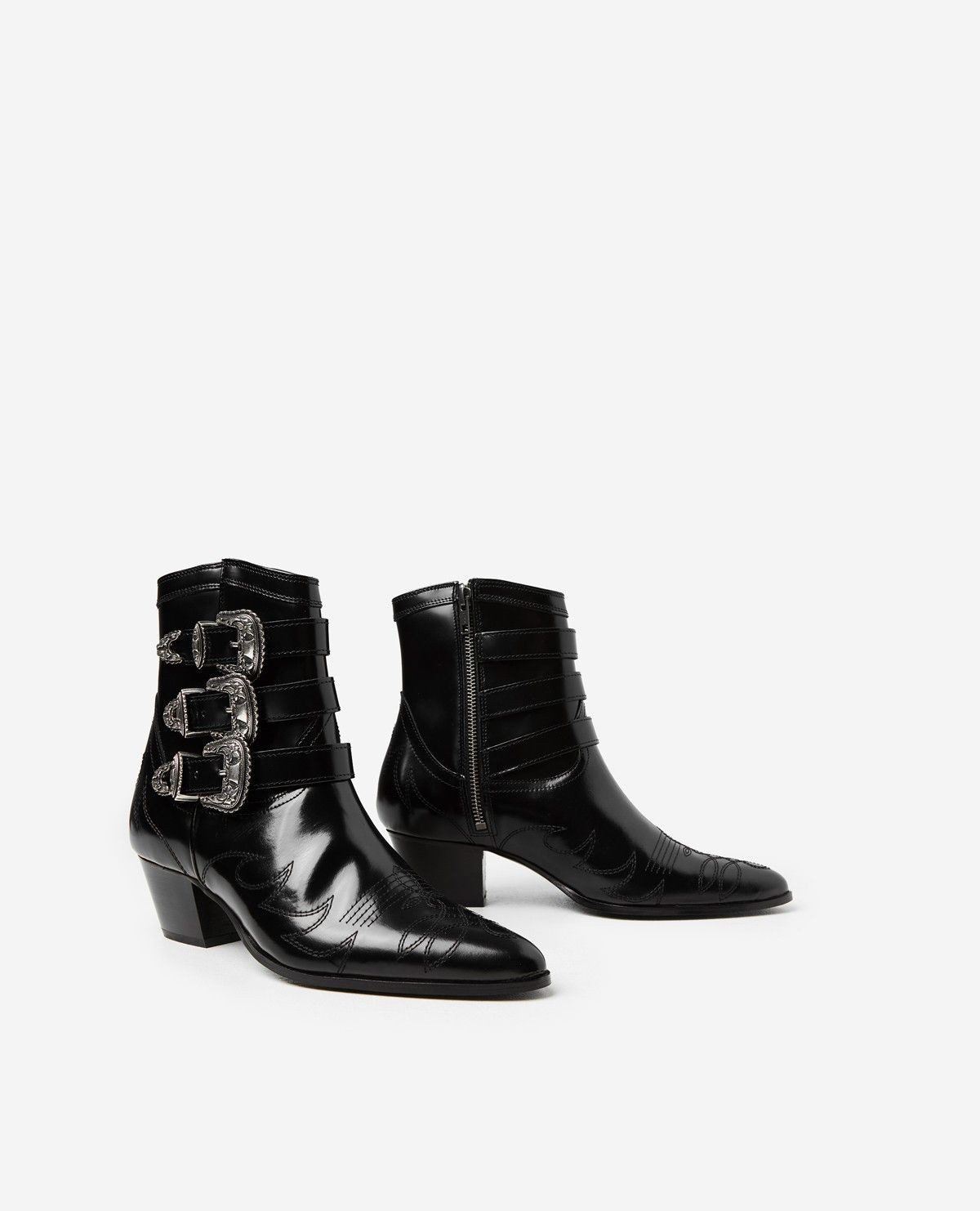 6470798569bcac Black leather cowboy boots with country-style buckles - Women - The Kooples