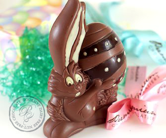 Easter chocolates and candy for kids with food allergies and vegan easter milk free nut free chocolate premium chocolatiers big easter bunny holding a decorated egg easter gift baskets negle