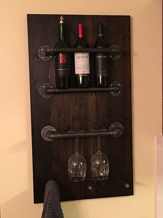 Custom made black iron pipe wine rack; holds, bottles, glasses, and other accessories. Main pipe is 1/2 with 1/8 holders at the . bottom. Great for the bar or kitchen! Custom colors available on wood and pipe.