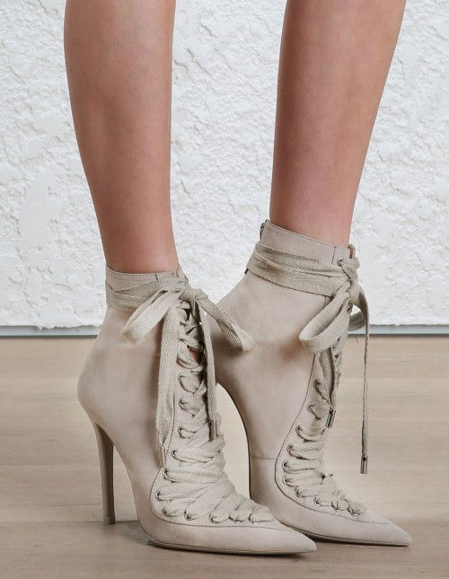 Zimmermann Lace Up Ankle Boot. Model Image. This shoe fits true to size take