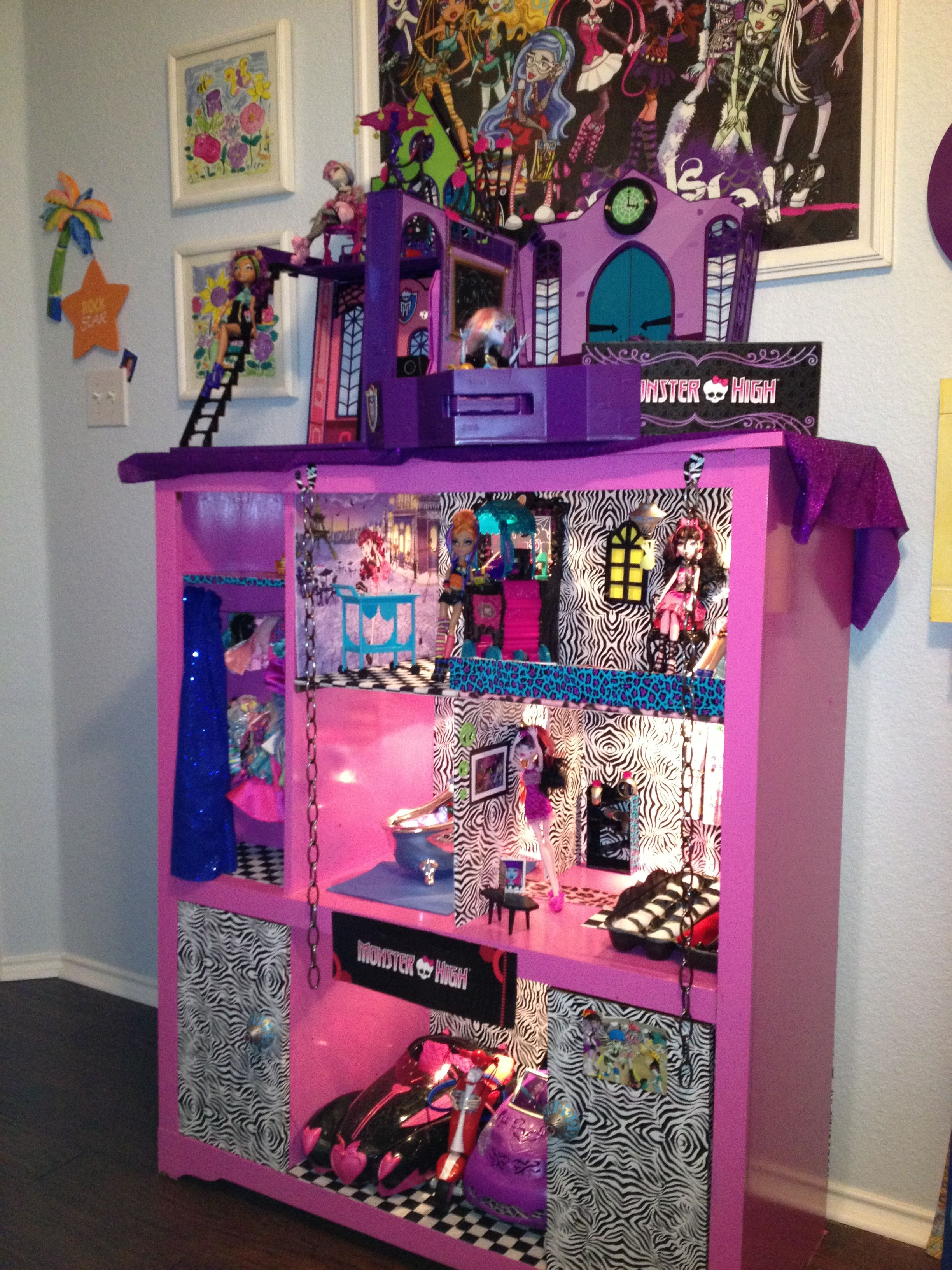 Monster High Dollhouse made from a $20 Goodwill TV Cabinet. Our granddaughter loves it!