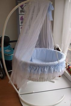 New Leipold Round swinging crib. complete with stand and drape