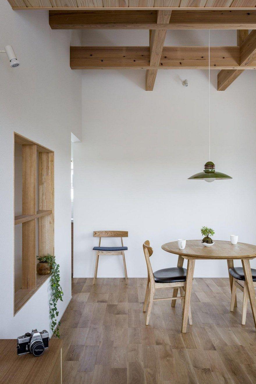 BoxShaped Japanese Home with Warm Minimalist Interior