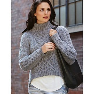 Cozy pullover featuring cables and an on-trend hi-lo hem.
