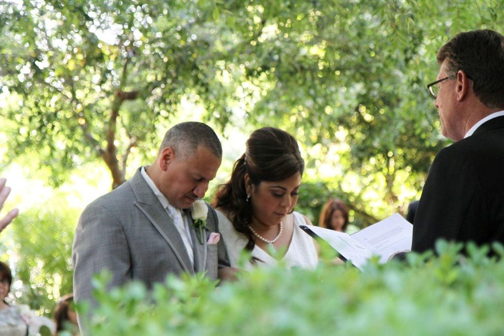 A moment of prayer for this Bride and Groom. Guillen wedding. Gorgeous couple at Edwards Mansion Redlands, Ca