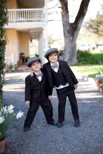 Ringbearers in three-piece tuxes, caps, and bowties // Megan Clouse Photography