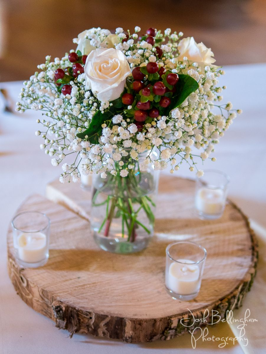 Baby S Breath And Roses On A Rustic Wood Slab Centerpiece Candles And Intimate Weddin Wood Slab Centerpiece Wedding Niagara Wedding Wedding Flower Inspiration