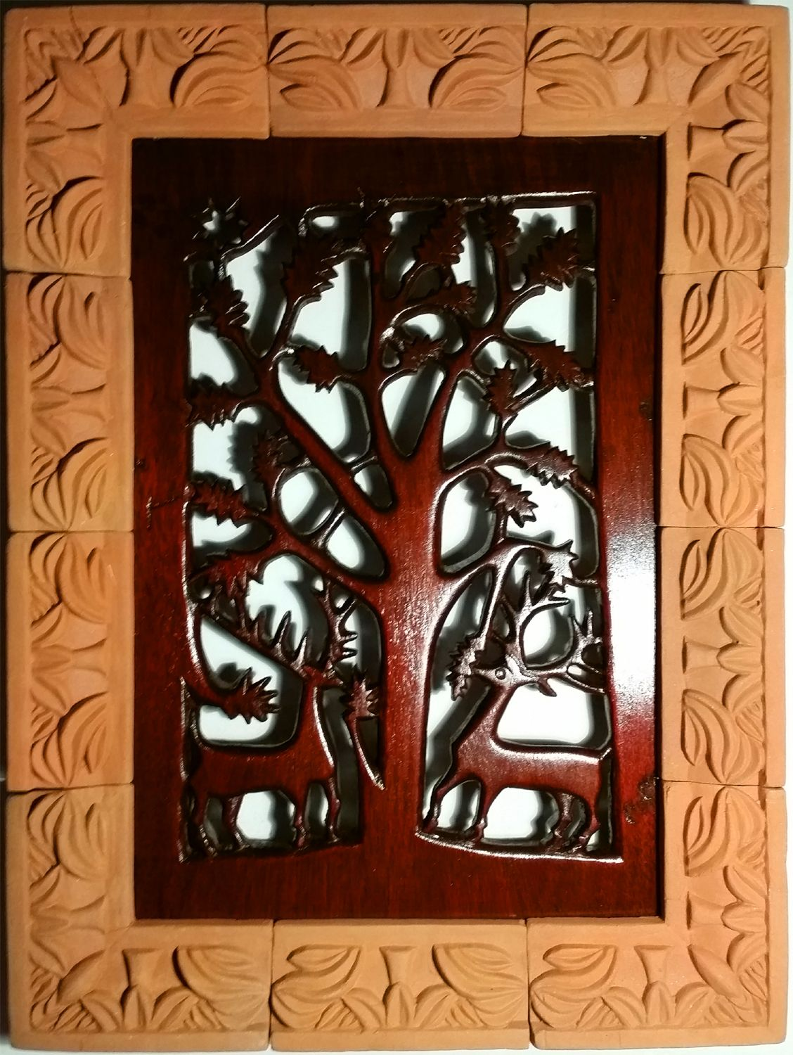 Carved panel in reclaimed mahogany with relief moulded terra cotta ...