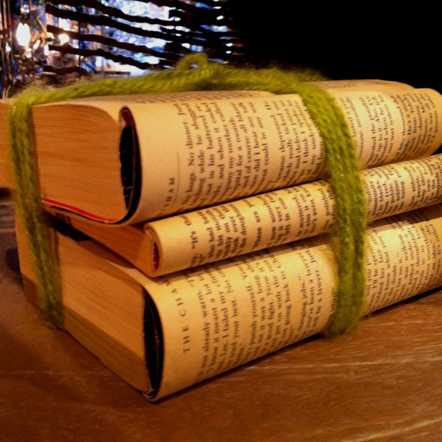 Fold Back A Few Pages Of Old Paperback Books Stack And Tie With