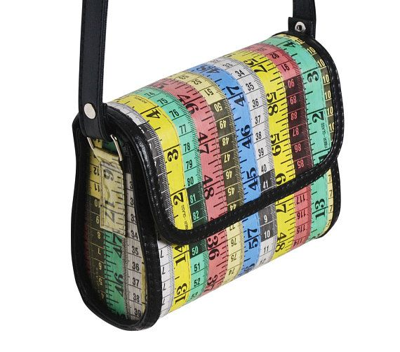 This small cross body bag is made using colorful measuring