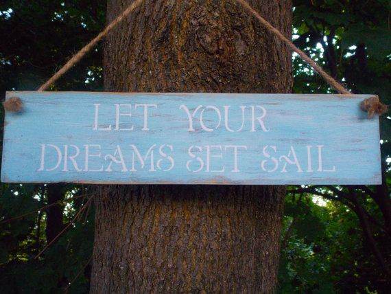 """$25 This """"Let Your Dreams Set Sail"""" Sign is made on reclaimed wood. It has been distressed with Coastal Blue paint and has White stenciled lettering. It has a Jute rope for hanging. It measures approximately 13.5 x 3.5 inches.   I love this sign for any home that has a coastal decor. It is also a cute Baby Nursery sign!"""