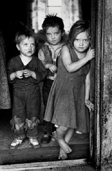 Children of a disabled coal miner stand in the doorway of their Appalachian home in the early 1960s. (Photo by Jack Corn, now belonging to Vanderbilt University.)