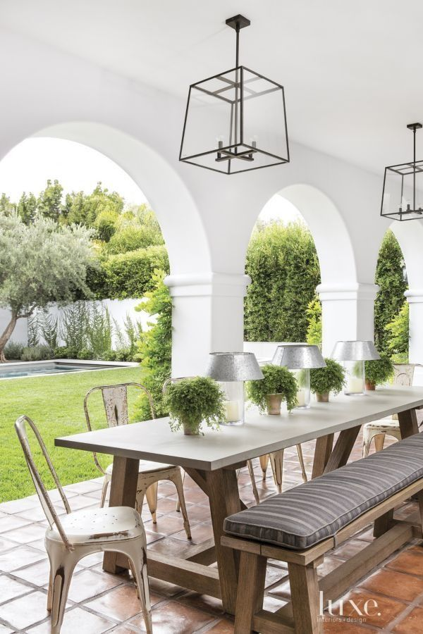 Spanish Colonial home with covered veranda outdoor dining room