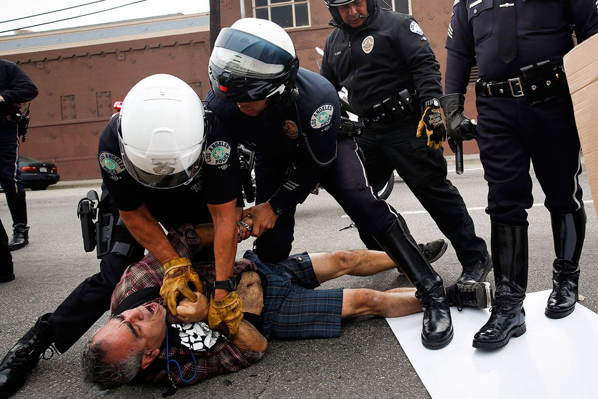 Lapd Motorcycle Officers Detain A Man In Los Angeles During A Rally Against The Decision To Not Indict Darren Wils Harley Davidson Harley Davidson Bikes Harley
