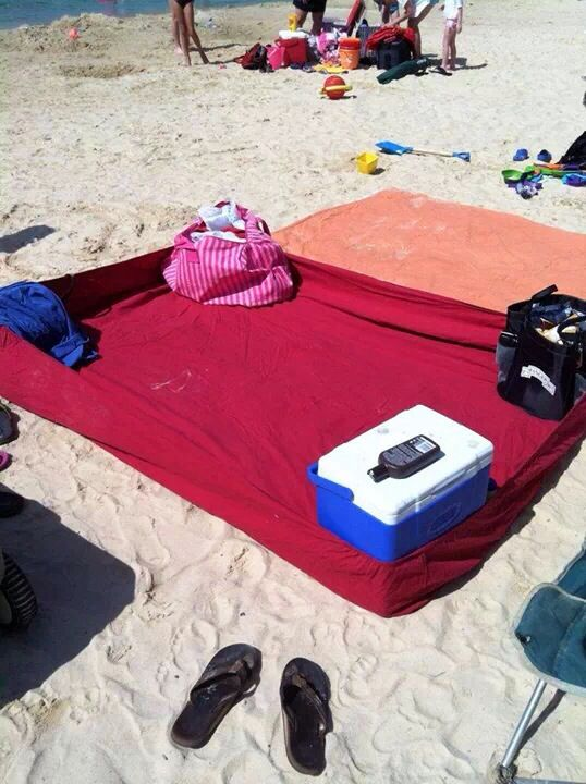 Great idea for the beach! Use a fitted bed sheet to keep sand off of things. Just put things to weigh it down in each corner.