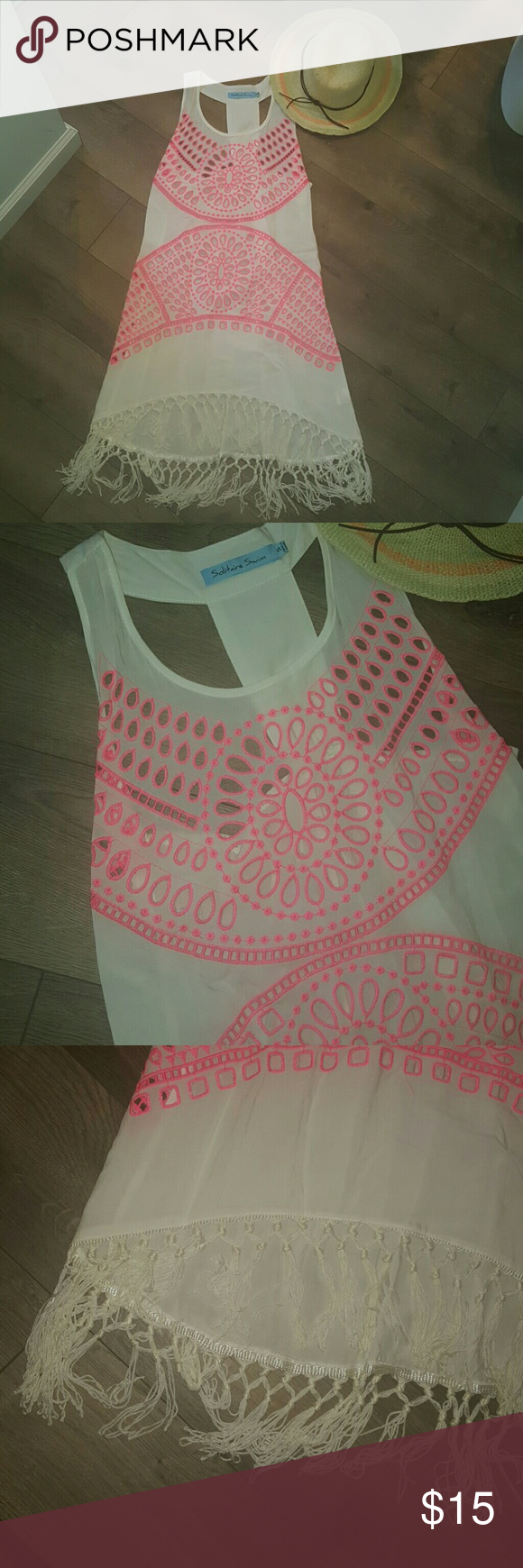 SWIM COVERUP SUPER CUTE!!!! Open lace work on front with tassell high low hem. Back has a cute T back. Worn 1 time. Just need to purge!!! Solitaire Swim Swim Coverups