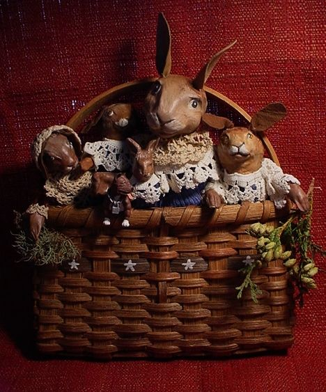 A basket Case, now on eBay, an antique basket and 5 of my rabbits. (decamp) item number 111711602844 COME SEE.