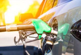 Oil prices edge up despite unexpected U.S. crude inventory build.