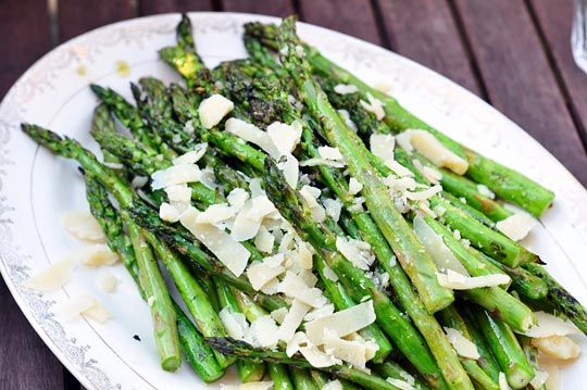 Grilled asparagus with sprinkled aged Parmesan cheese.