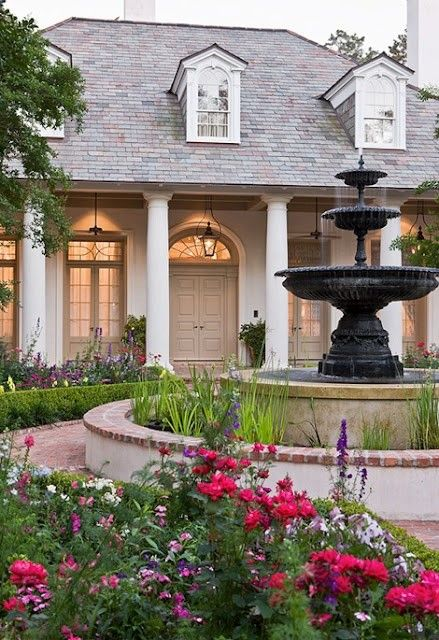 Southern Colonial home w/the sound of water and lots of color ... on flower bed designs, home rose garden designs, home courtyard designs, outdoor flower designs, home lawn designs, home landscaping designs, home vegetable garden design, home greenhouse designs, home fortress designs, home beach designs, home lake designs, home flower landscape, home patio designs, home depot garden flowers, home deck designs, home gate designs, home garden design plan, home library designs, home park designs, home flower furniture,