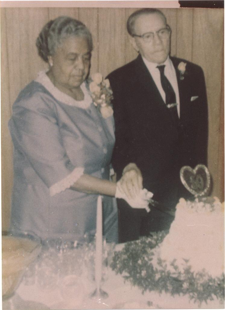 Mrs. Elizabeth Hopgood and Mr. Joseph Hopgood cutting their 50th Wedding Anniversary cake, 1967.