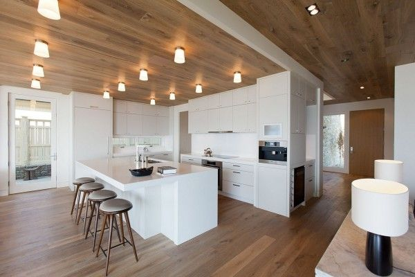 Lakeside Summer Home by Robert Bailey Interiors - White kitchen