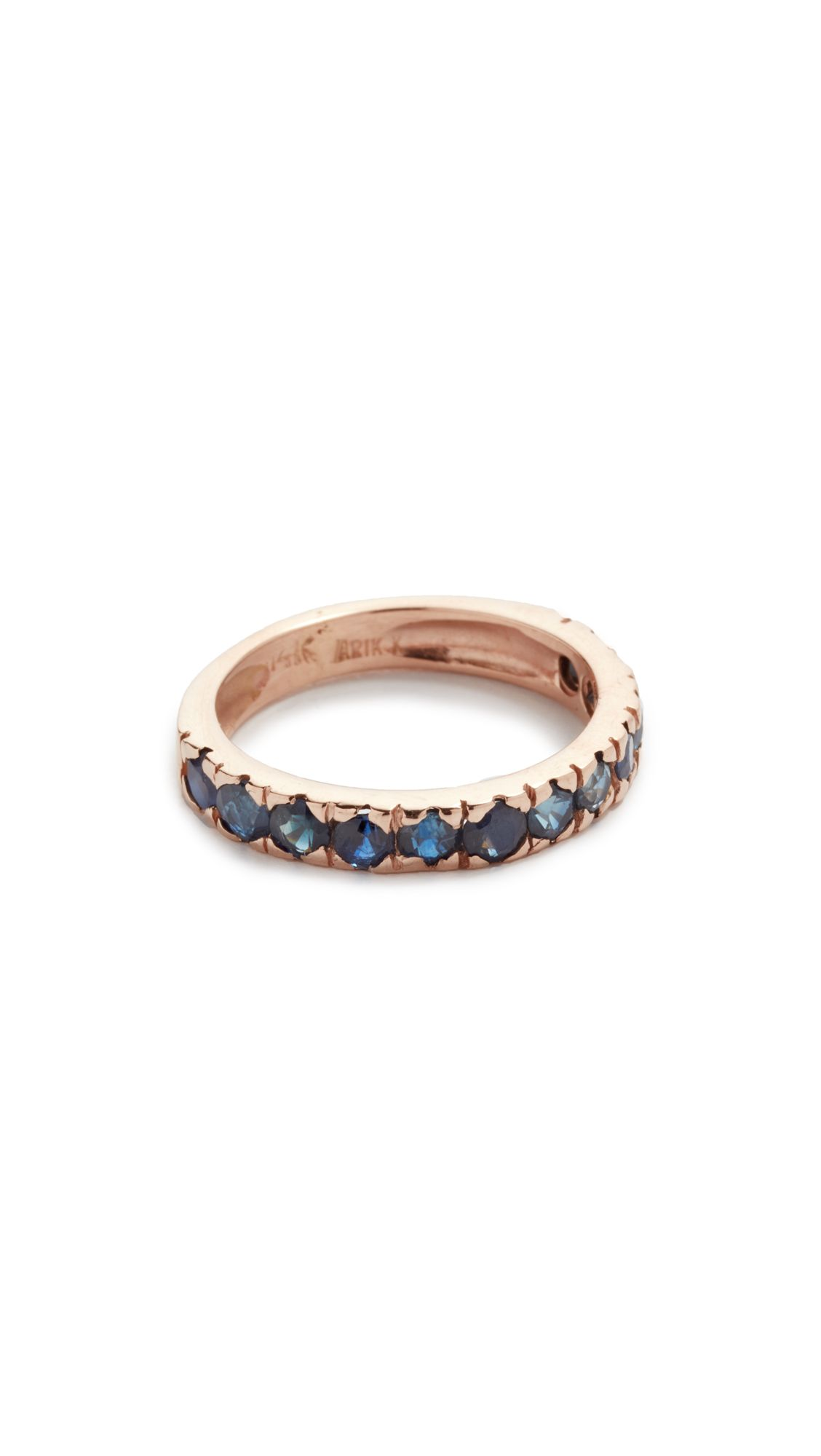 Faceted sapphires stud the textured band on this rose-gold Arik Kastan stacking ring.