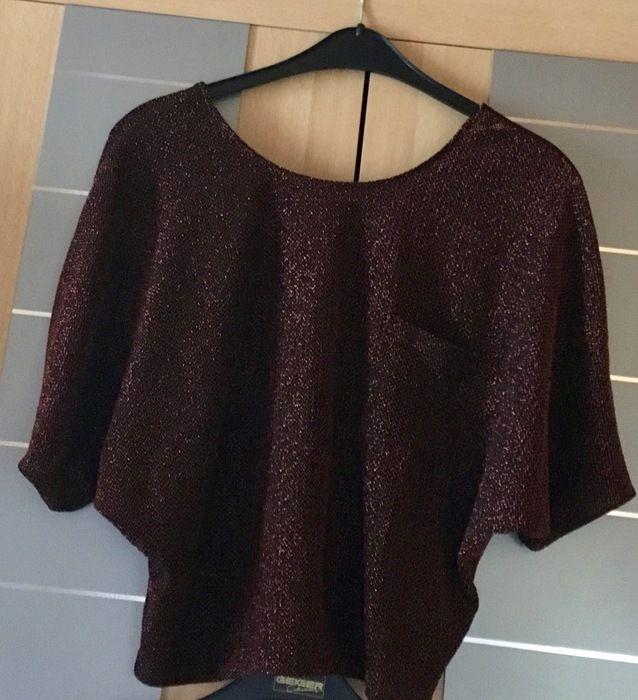 1b2593b7f2bfca Sieh´s dir an: http://www.kleiderkreisel .de/damenmode/oberteile-and-t-shirts-sonstiges/138471319-oberteil-mit-fledermausarm-bronzefarben-mit- glitzer.