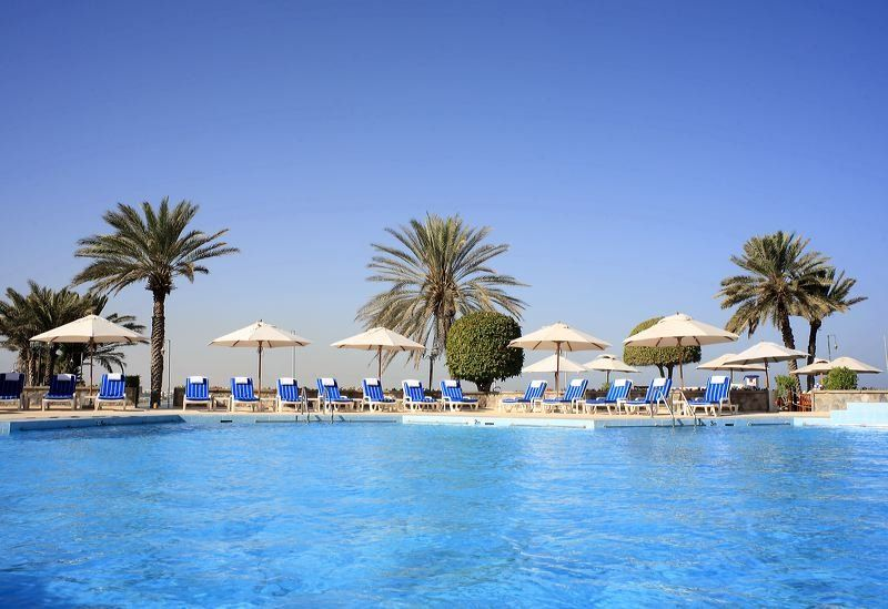 Cool Down In The Azure Blue Waters Of The Pool At The Crowne Plaza Muscat Oman Hotels Muscat Trip Advisor