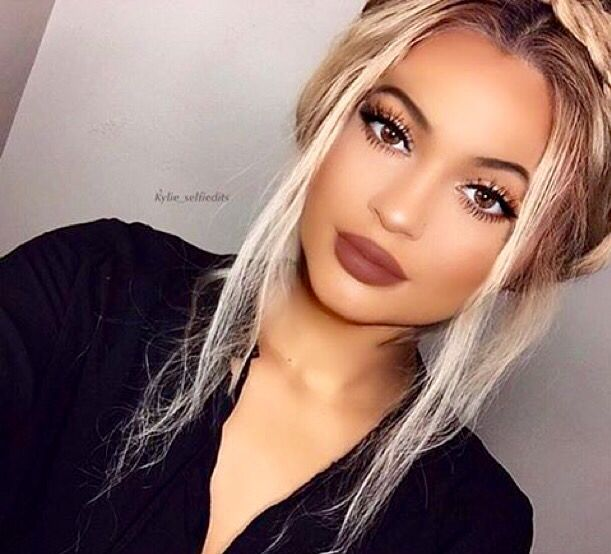 (Kylie Jenner)...A little less blonde in the hair...more of a caramel brown with champagne and honey highlights...but this makeup for winter.