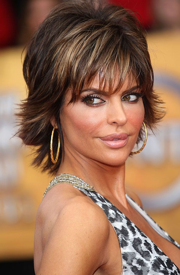 6084cadc5192 Lisa Rinna Lisa Rinna wore her cool razored cut with eye-enhancing bangs  and lots of volume at The Celebrity Apprentice season four finale.
