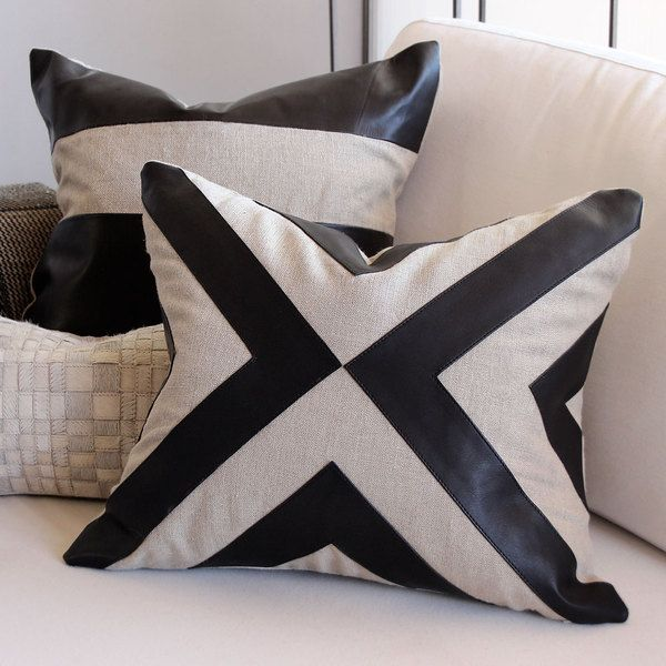 As Shown: Diverge Pillow Size: 17 x 20 inches Material: Linen and Leather Color: Natural and Black  Description: A distinctive mix of light and dark, leather and linen makes for a modern interpretation of African Kuba or Mud Cloth. Artisans apply leather appliqué  to linen, then back with matching linen or leather. Fitted with a feather and down inner, each is individually crafted for you. Whether you're a traditionalist, a minimalist, or anywhere in between, this strikingly neutral piece…