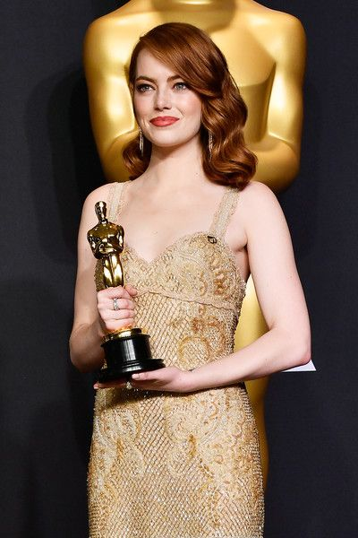 Emma Stone Photos Photos - Actress Emma Stone, winner of Best Actress for 'La La Land' poses in the press room during the 89th Annual Academy Awards at Hollywood