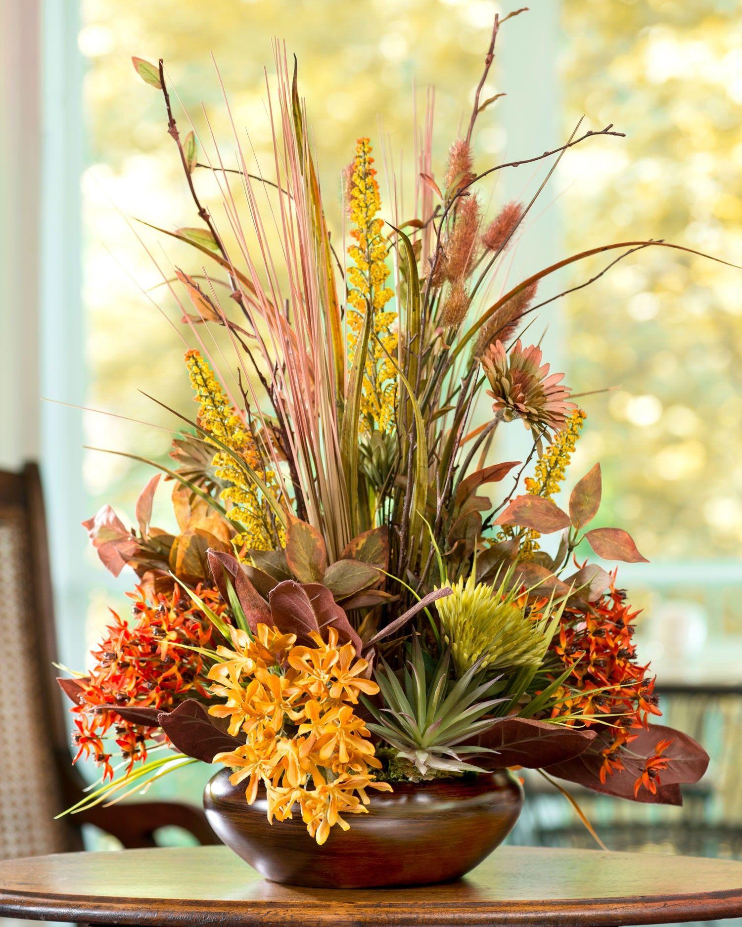 Arranged In A Glazed Golden Brown Ceramic Vase This Beautiful Silk