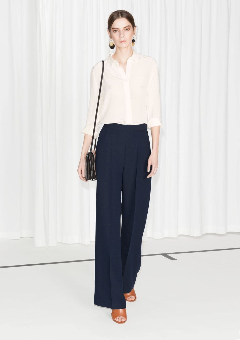 Wide tailored trousers blue dark tailored trousers beige shirt